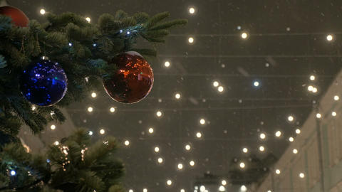 New Year's balls hang on the Christmas tree, colored illumination. Red balls Footage