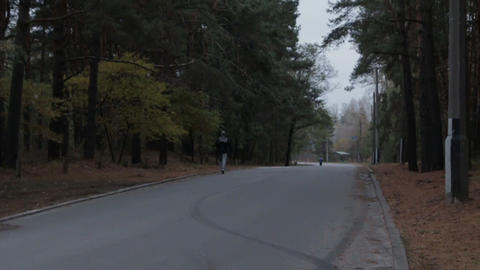 Man Running in the Forest Road 영상물