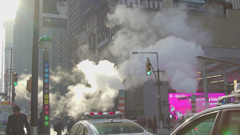 Street of Manhattan on the day with steam coming from pipe. New York Footage