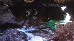 Waves flowing slightly into a cave Footage