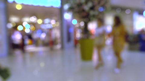 Blurred shop entrance in modern shopping mall. 4K bokeh video Footage