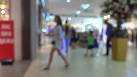 Unrecognizable customers walking in modern shopping center. 4K bokeh video Footage