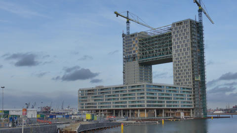 AMSTERDAM, NETHERLANDS - DECEMBER 29, 2017. Modern building construction site Footage