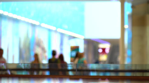 Blurred customers walking in modern shopping center. 4K background bokeh shot Footage