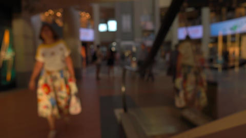 Defocused people on moving staircases in modern shopping center. 4K background Live Action