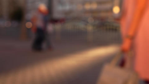 Defocused street in the evening. Cars and pedestrians. 4K background bokeh shot Footage
