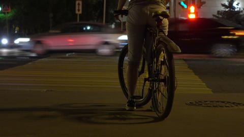 Female biker standing at red light on crosswalk. Traffic... Stock Video Footage