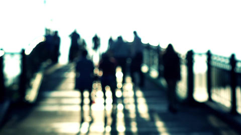 Blurry men and women silhouettes on sunny arched bridge. Super slow motion shot Footage