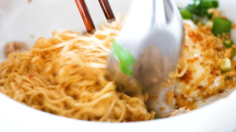 hot instant noodles mixed with minced pork and vegetables, asian style, served 영상물