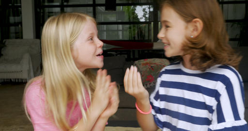 Two young girls whispering and planning something together and then agreeing, Footage
