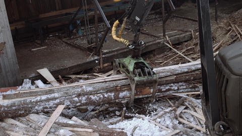 Truck loader crane claw lifts up sawmill wooden waste Live Action