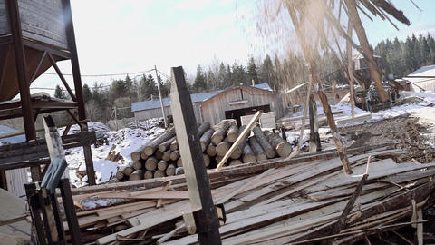 Truck loader crane claw picks up sawmill planks waste Live Action