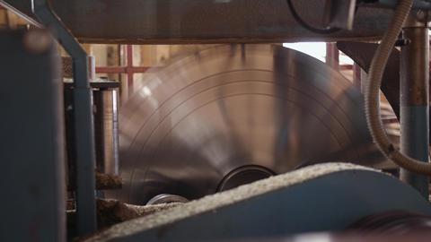 Twisting industrial big circular blade saw at woodwork machine Footage
