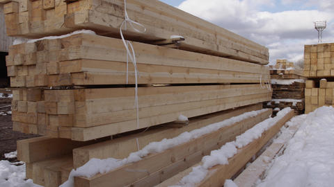 Piles of packed lumber blocks stored in yard of sawmill Footage