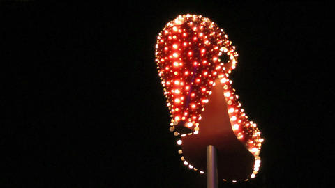 Lit up high heel shoe in Las Vegas Stock Video Footage