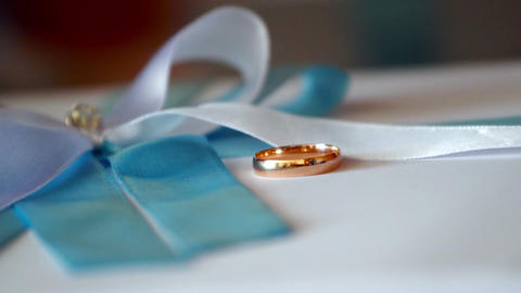 Falling wedding rings Stock Video Footage