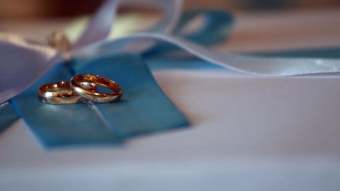 Wedding rings in a beam of light Stock Video Footage