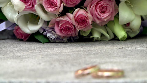 Wedding rings and bouquet Stock Video Footage