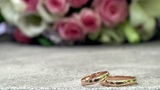 Wedding rings and bouquet Footage