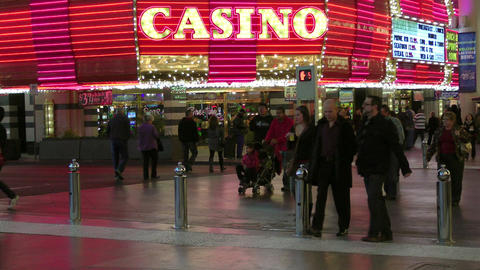 Pedestrians in front of a casino Stock Video Footage