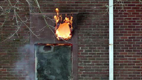 Fire Burns Through Wooden Door Stock Video Footage