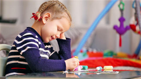 Little girl painting in concentration Footage