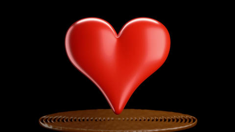 Red heart shape and hot chocolate splashes, slow motion.... Stock Video Footage