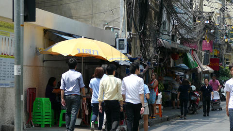 Office people walking during lunch time in Silom Live Action