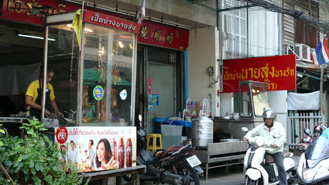 Street scene with chinese restaurant in Bangkok Footage