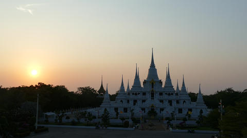 Sunset at the Buddhist stupa with multiple spires at Wat Asokaram Footage
