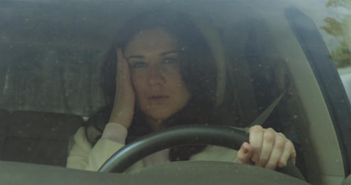 Crying Woman Driving A Car stock footage