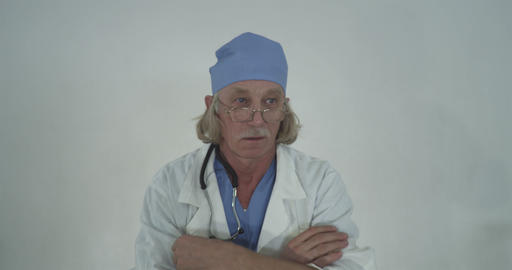 Portrait Of A Serious Senior Male Doctor Footage