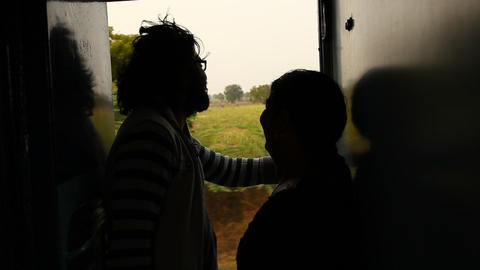 Silhouette of Lovers in Train Footage