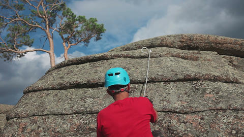 Rock climber climbing on a rock Stock Video Footage
