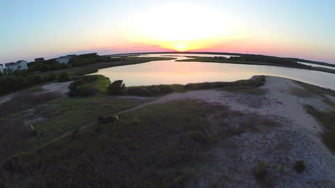 Aerial lift to beautiful sunset over sound Footage
