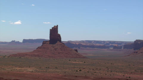 Aerial shot of monument valley buttes zoom out Live Action