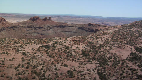 Aerial shots of red rock desert buttes and sage desert Live Action