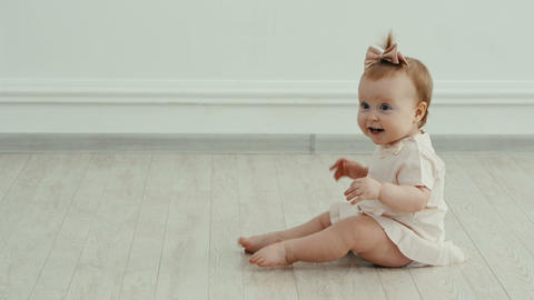 funny baby girl is happy. She smiling and laughs Footage