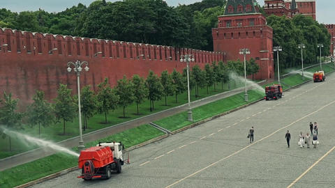 Watering machines in action near Moscow Kremlin wall. Slow motion video Footage