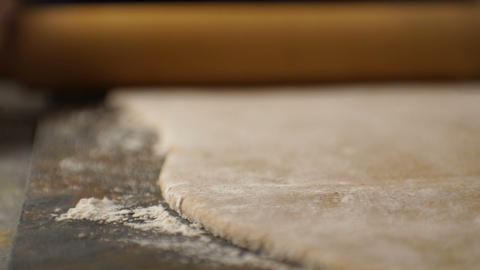 Thin layer of dough and a rolling pin on the table. Video Footage