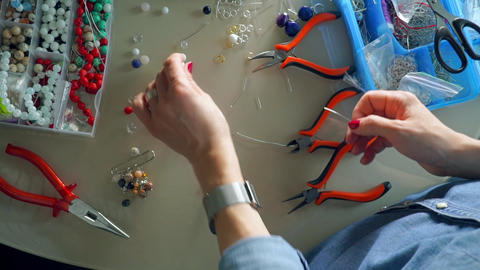 Work place of accessories artist making bead earrings, view from above Footage