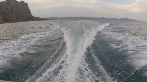 Trail on sea surface behind fast moving motor boat Footage