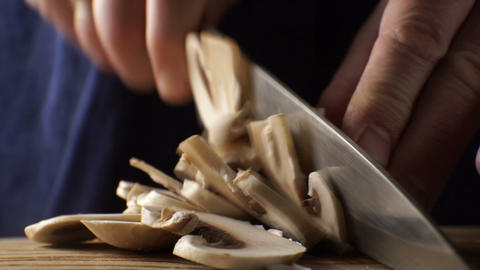 Slicing fresh champignons into thin slices. Video Footage