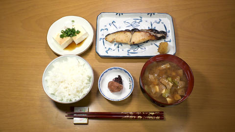 Japanese food : Standard popular set meal. Rice, Miso soup, Umeboshi, Tofu Footage