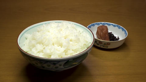 Hot steamed plain Japanese rice in a bowl GIF