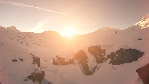 Flying trough snow landscape winter nature sunset aerial view fly over Footage