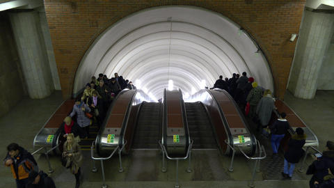 Moscow metro passengers on moving staircases. March Footage