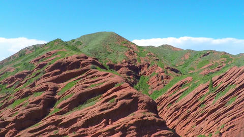 Aerial video of pink rocks with scarce vegetation against... Stock Video Footage