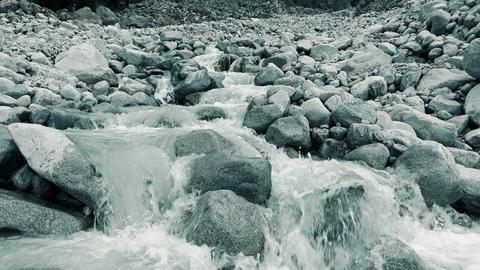 Mounain river flows on big rocks 4K video, close up version Footage