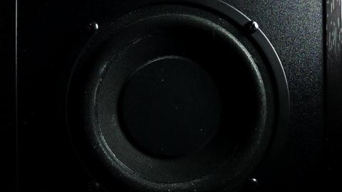 Subwoofer bass loud speaker in action. Super slow motion low key shot Footage